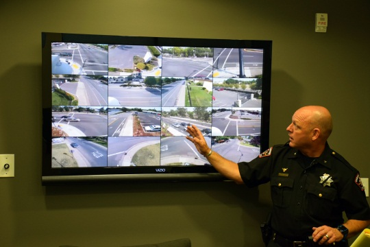 Rancho Cordova Police Chief Michael Goold shows live feeds from the surveillance cameras.
